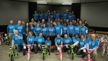 aig build a bike team building event in new york to help kids in foster care